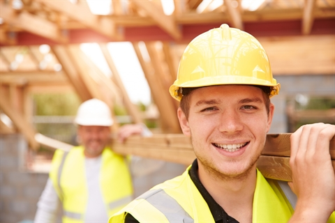 Builder-And-Apprentice-Carrying-Wood-On-Construction-Site-000071099731_Double.jpg