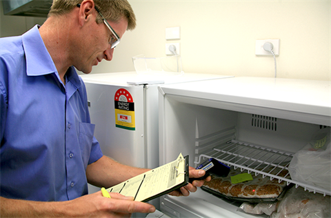 Food Business Inspections and Grading - Man inspecting Freezer.
