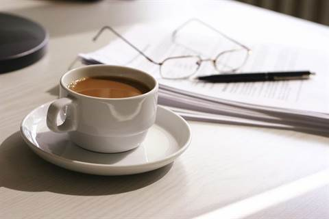 Opening a food business - Coffee, paper and pen on a desk.