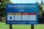 Level 1 water restrictions sign.