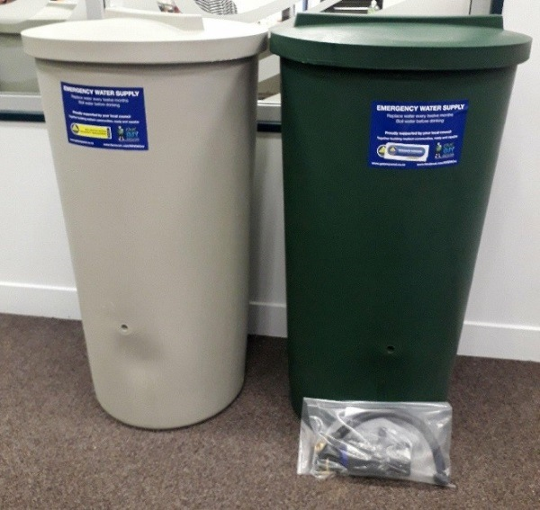 Emergency rainwater 200 litre tanks in Heritage green and birch grey.